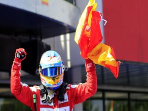 Fernando Alonso with the Spanish flag after winning the Spanish Grand Prix 2013