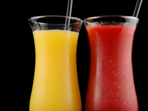 Glasses with mango and strawberry juice