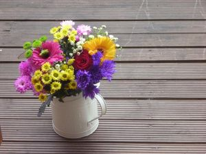 Rustic vase with very colorful flowers