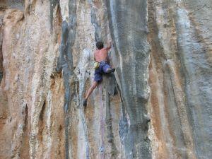 Climbing a big rock wall