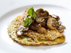 Omelette with mushrooms and aromatic herbs