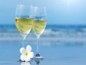 Two glasses of white wine in the sea