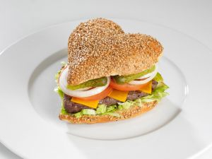 Hamburger with heart shaped in a seed bun