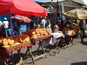 Selling bread in Dordoy Bazaar, Bishkek, Kyrgyzstan