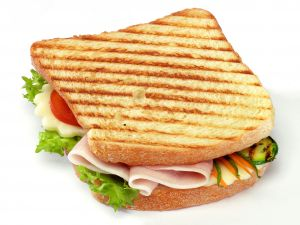 Sandwich with grilled vegetables, ham and cheese