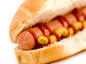 Bocadillo of sausage with ketchup and mustard