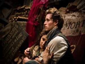 "Actors Eddie Redmayne and Samantha Barks in ""Les Miserables"""
