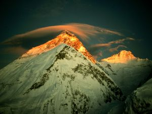 Reflection of the sun on the summit of Everest