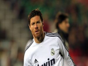 Xavi Alonso with the Real Madrid shirt