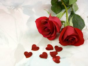 Two red roses with hearts