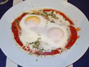 Shirred eggs (eggs with tomato)