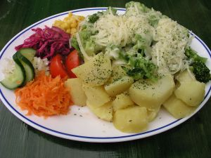 Broccoli with cheese, potatoes and other boiled vegetables