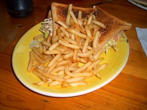 A sandwich with fries