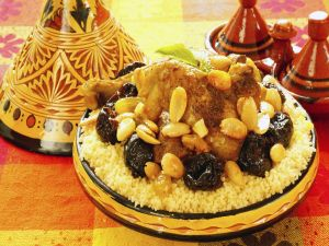 Couscous tagine with chicken, prunes and almonds (Moroccan cuisine)