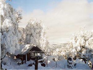 Snow covered cabin in the Cerro Otto, Bariloche, Argentine Patagonia
