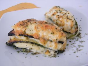 Mille-feuilles of zucchini with lot of cheese