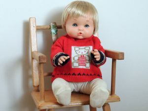 Doll sitting in a chair