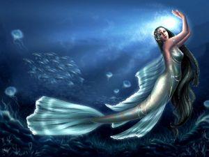 Mermaid dancing among fish