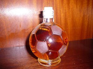 Rum bottle with shape of soccer ball