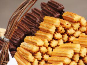 Basket of sugar churros and chocolate churros