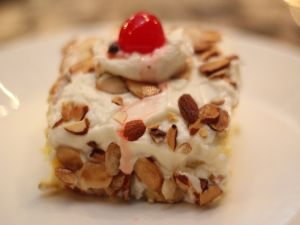 Cake with a cherry and almonds
