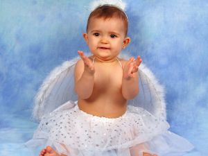Baby dressed as little angel