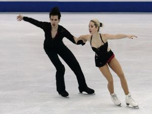 Shtina Martini and Kiefer Seferin skating over ice
