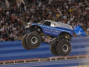 A monster truck jumping into a Monster Jam show in Las Vegas