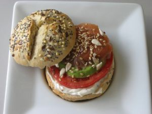 Seed bread stuffed with salmon, avocado, tomato and cream cheese