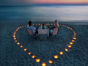 Loving couple dining at beach
