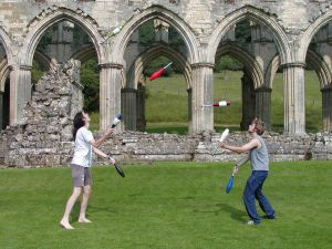 Two jugglers throwing 7 maces