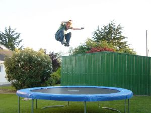 Young jumping on an elastic bed