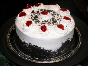 Cream cake with cherries