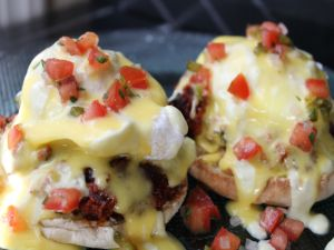 Eggs Benedict with tomato cubes