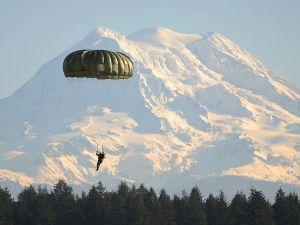 Canadian soldier descending in front of Mount Rainier, Washington