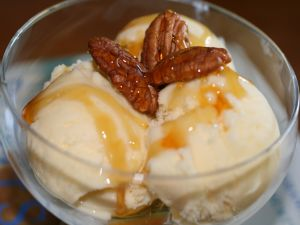 Cup with ice cream and pecans