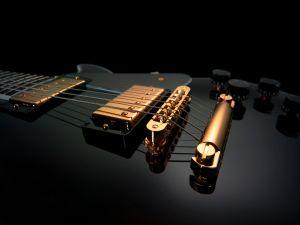 A shiny black guitar