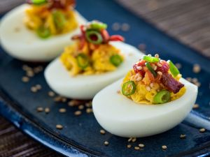 Eggs stuffed with bacon and chilli