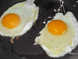 Two eggs on a griddle
