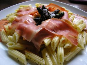 Penne rigate with slices of serrano ham and olive oil