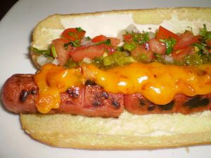 Hot Dog with cheddar cheese and chopped vegetables