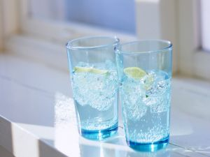 Two glasses of water with lemon