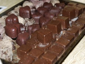Chocolate truffles with shape of heart and squared