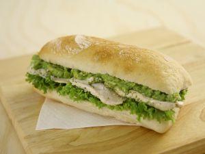 Fresh bread bocadillo with escarole and chicken breast