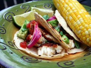 Fish, avocado and a corn cob