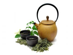 Bowls, teapot and green tea leaves