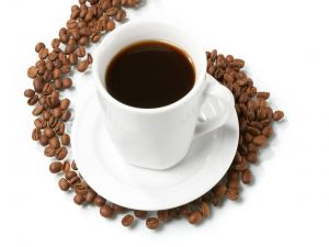 Cup of coffee with grains around