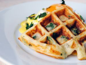 Waffle with aromatic herbs and egg