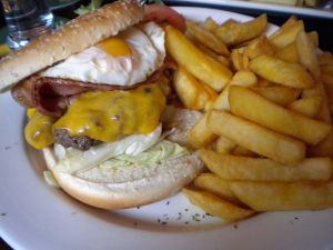 Burger with egg and potatoes