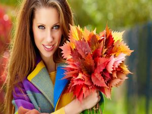 Beautiful woman with a bouquet of leaves